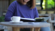 Woman reading a book at relax time with coffee