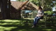 Woman Reading on Garden Bench