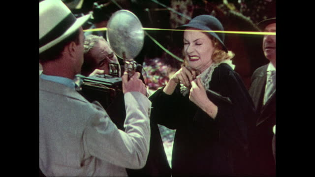 Woman (Carole Lombard) receives key to NYC in press constructed ceremony