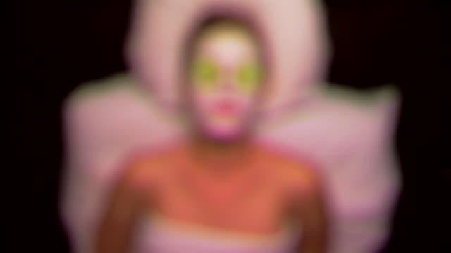Woman receiving a facial treatment