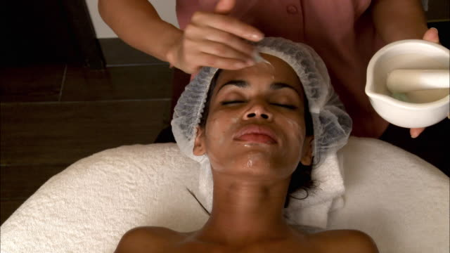 CU HA Woman receiving face massage / Brussels, Belgium