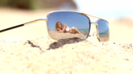 woman reflected in sunglasses