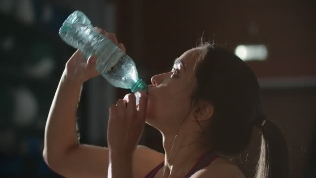 Woman refreshing after workout