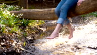 DS SLO MO Woman refreshing her feet in creek