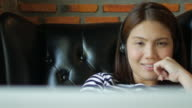 Woman relaxing and listening to music with laptop