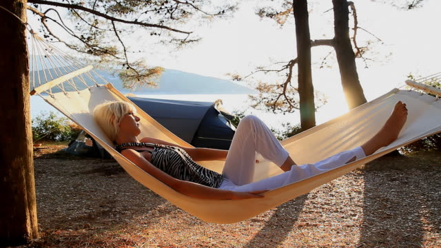 HD DOLLY: Woman Relaxing In Hammock On The Beach