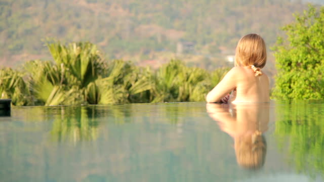 Woman Relaxing in Private Swimming Pool on Vacation