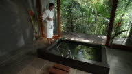 WS, CS, Woman relaxing in spa bath, Mossman, Queensland, Australia