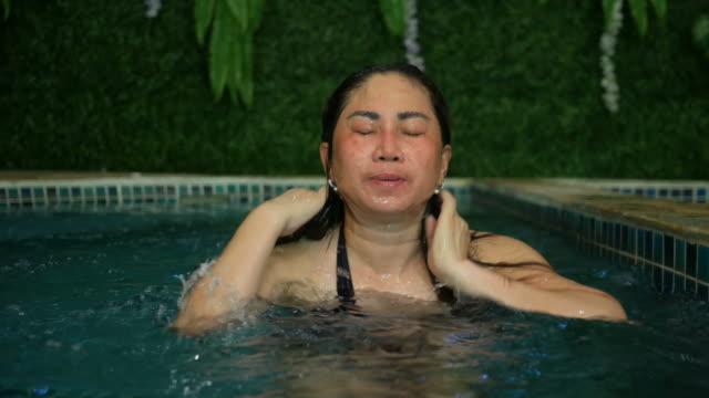 Woman Relaxing In spa pool
