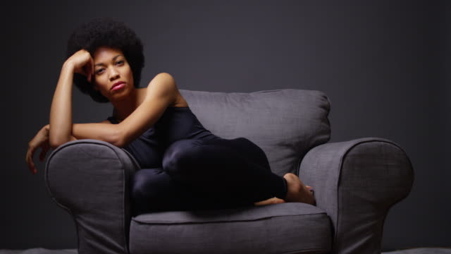 woman relaxing on chair looking at camera