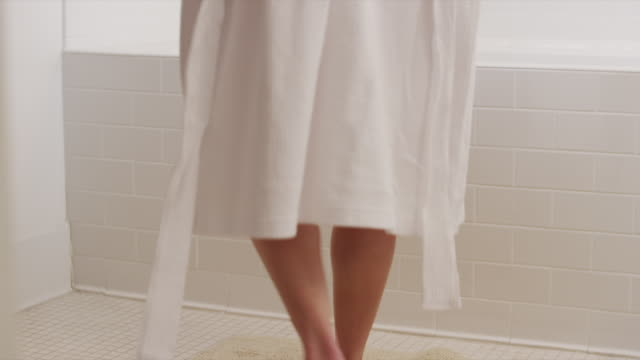MS Woman removing bathrobe and taking bath / Salt Lake City, Utah, USA