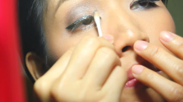 woman removing eye make-up