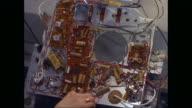 CU HA Woman repairing electronic circuit board / United States