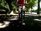 A woman riding a bike Sweden.