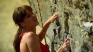 CU Woman rock climber ascending rock face/ Krabi, Thailand