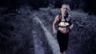 SLO MO DS Woman running a trail marathon at sunset