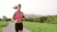 SLO MO TS Woman running and listening to music