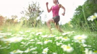 SLO MO TS Woman running in high grass