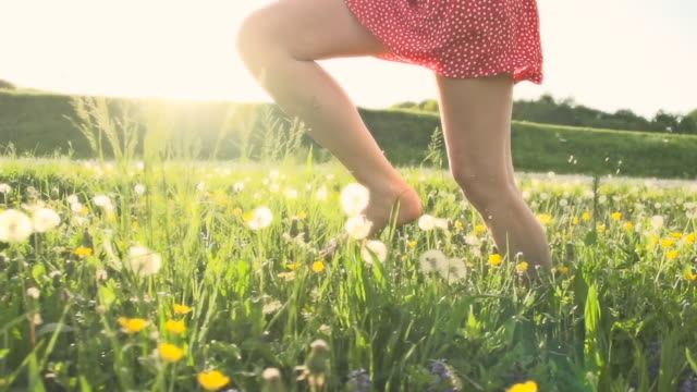 HD SUPER SLOW MO: Woman Running In Meadow