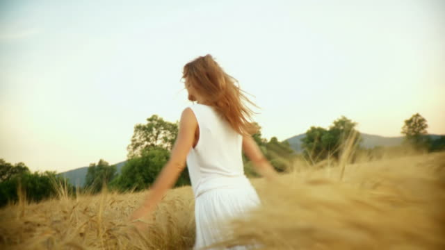 HD SLOW-MOTION: Woman Running In Wheat