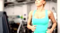 Woman running on a treadmill.