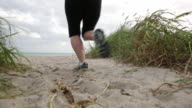 WS TS Woman running on beach.