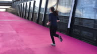 Woman running on pink cycleway in Auckland New Zealand