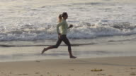 A woman running on the beach.