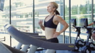 MS PAN Woman running on treadmill machine in gym / Vancouver, British Columbia, Canada