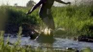 Woman Running Through Mud