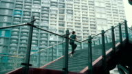 Woman running up staircase