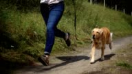 Woman running with dog.