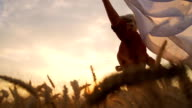 HD SUPER SLOW-MOTION: Woman Running With Veil In Field