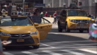Woman runs to catch up with friend getting into taxi on busy New York City street