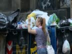 A woman scavenges for food in Naples Italy during the country economic crisis August 2011