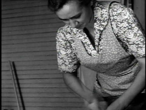 1940 CU Woman (Hazel Parkinson) scrubbing laundry on washboard / United States