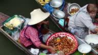 MS Woman  selling delicious food out of her boat at   Damnoen Saduak Floating Market  / Bangkok, Ratchaburi Provinvr, Thailand