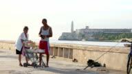 Woman Selling Food Items in El Malecon