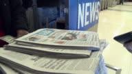 CU TD Woman selling newspapers at news stand at subway station, San Francisco, California, USA / AUDIO