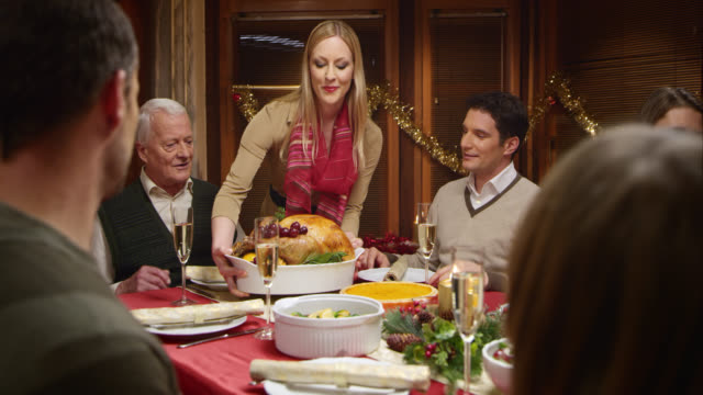 SLO MO of woman serving turkey to the Christmas table