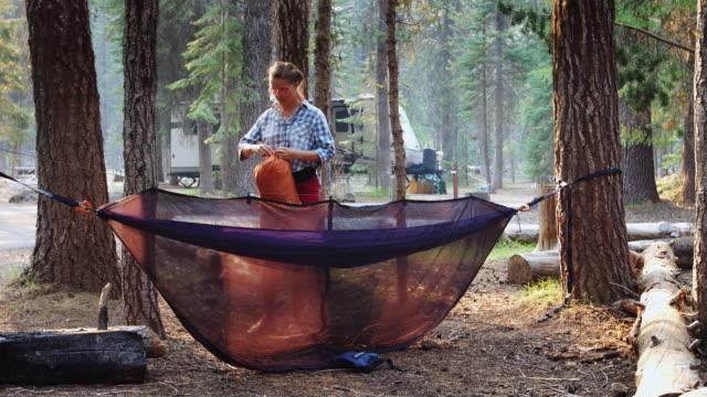 Woman Setting Up Camping Hammock
