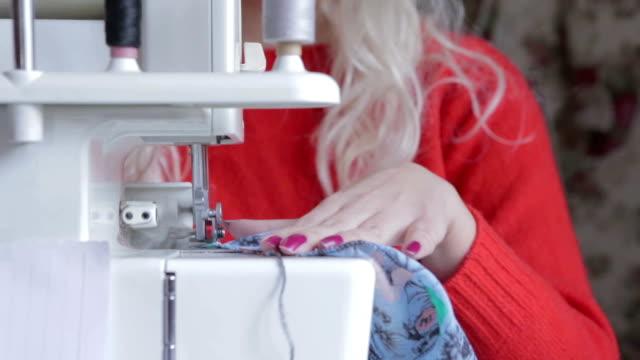 Woman sewing clothing close up shot
