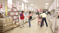 Woman shopping in home improvement warehouse for tile