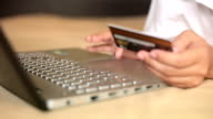 Woman shopping on internet by credit card