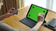 Woman shopping on Tablet PC with Credit card, Chroma key