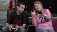 Woman showing her boyfriend her phone