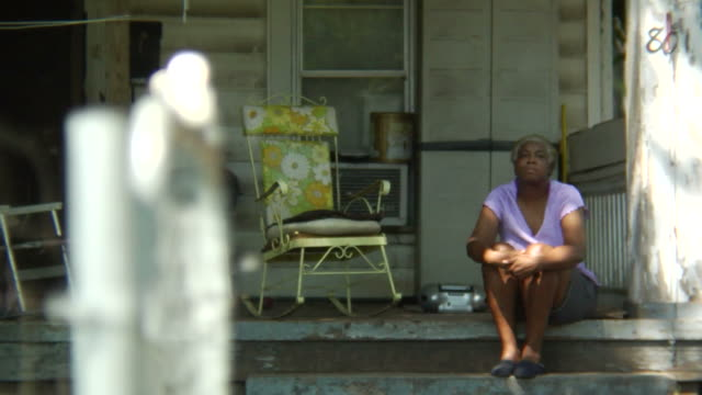 Woman sits on porch