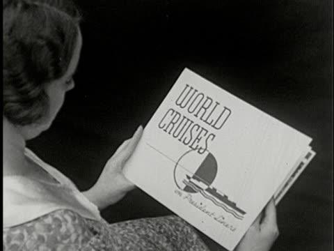 CU, HA, B/W, Woman sitting and reading brochure