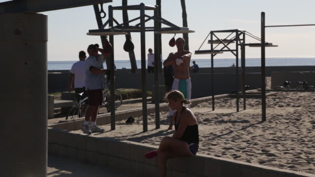 woman sitting at muscle beach