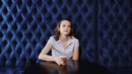 Woman Sitting Down for Post Work Drink